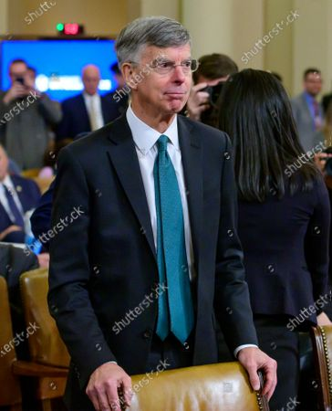Stock Image of William B. Taylor, Chargé d'Affaires Ad Interim, Kiev, Ukraine, United States Department of State, returns from a break to continue giving testimony before the US House Permanent Select Committee on Intelligence public hearing as they investigate the impeachment of US President Donald J. Trump on Capitol Hill
