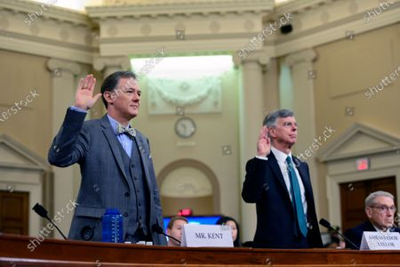 George Kent, Deputy Assistant Secretary for European and Eurasian Affairs, United States Department of State, left, and William B. Taylor, Chargé d'Affaires Ad Interim, Kiev, Ukraine, United States Department of State, right, are sworn-in to testify during the US House Permanent Select Committee on Intelligence public hearing as they investigate the impeachment of US President Donald J. Trump on Capitol Hill
