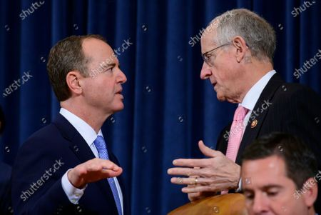 Stock Picture of United States Representative Adam Schiff (Democrat of California), Chairman, US House Permanent Select Committee on Intelligence, left, and US Representative Mike Conaway (Republican of Texas) right, converse during a break in the hearing where William B. Taylor, Chargé d'Affaires Ad Interim, Kiev, Ukraine, US Department of State, and George Kent, Deputy Assistant Secretary for European and Eurasian Affairs, US Department of State are giving testimony during the committee's public hearing as they investigate the impeachment of US President Donald J. Trump on Capitol Hill