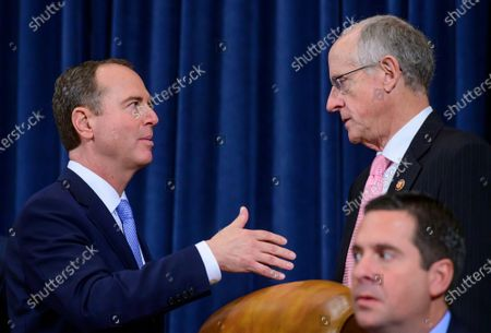 United States Representative Adam Schiff (Democrat of California), Chairman, US House Permanent Select Committee on Intelligence, left, and US Representative Mike Conaway (Republican of Texas) right, converse during a break in the hearing where William B. Taylor, Chargé d'Affaires Ad Interim, Kiev, Ukraine, US Department of State, and George Kent, Deputy Assistant Secretary for European and Eurasian Affairs, US Department of State are giving testimony during the committee's public hearing as they investigate the impeachment of US President Donald J. Trump on Capitol Hill
