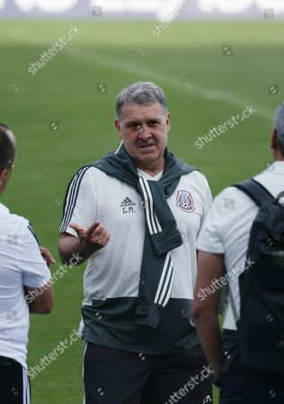 Mexico's head coach Gerardo Martino talks to his staff after a press conference, ahead a soccer match against Panama at the Rommel Fernandez stadium in Panama City, Thursday, Nov., 14, 2019. Panama and Mexico will face on Friday in a CONCACAF soccer match