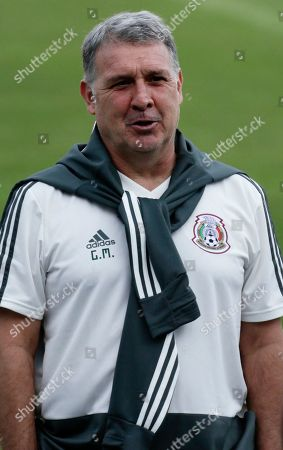 Mexico's national soccer team head coach Gerardo Martino talks to his staff after a press conference ahead a soccer match against Panama, at the Rommel Fernandez stadium in Panama City, Thursday, Nov., 14, 2019. Panama and Mexico will face each other on Friday in a CONCACAF soccer match