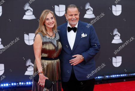 Stock Picture of Raul De Molina, Millie de Molina. Raul De Molina, right, and Millie de Molina arrive at the 20th Latin Grammy Awards, at the MGM Grand Garden Arena in Las Vegas