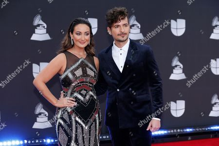 Stock Image of Karla Monroig, Tommy Torres. Karla Monroig, left, and Tommy Torres arrive at the 20th Latin Grammy Awards, at the MGM Grand Garden Arena in Las Vegas