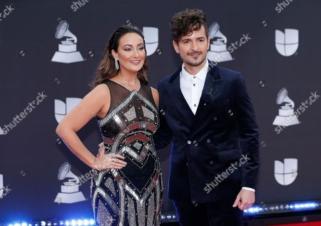 Karla Monroig, Tommy Torres. Karla Monroig, left, and Tommy Torres arrive at the 20th Latin Grammy Awards, at the MGM Grand Garden Arena in Las Vegas
