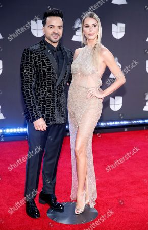 Luis Fonsi, Agueda Lopez. Luis Fonsi, left, and Agueda Lopez arrive at the 20th Latin Grammy Awards, at the MGM Grand Garden Arena in Las Vegas