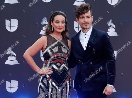 Karla Monroig (L) and Tommy Torres arrive for the 20th annual Latin Grammy Awards ceremony at the MGM Grand Garden Arena in Las Vegas, Nevada, USA, 14 November 2019. The Latin Grammys recognize artistic and/or technical achievement, not sales figures or chart positions, and the winners are determined by the votes of their peers - the qualified voting members of the Latin Recording Academy.