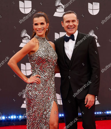 Stock Photo of Cristina Bernal (L) and Alan Tacher (R) arrive for the 20th annual Latin Grammy Awards ceremony at the MGM Grand Garden Arena in Las Vegas, Nevada, USA, 14 November 2019. The Latin Grammys recognize artistic and/or technical achievement, not sales figures or chart positions, and the winners are determined by the votes of their peers - the qualified voting members of the Latin Recording Academy.
