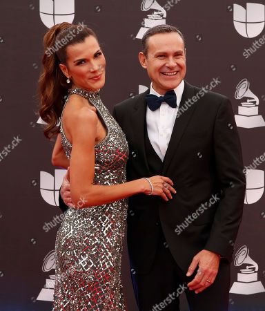 Cristina Bernal (L) and Alan Tacher (R) arrive for the 20th annual Latin Grammy Awards ceremony at the MGM Grand Garden Arena in Las Vegas, Nevada, USA, 14 November 2019. The Latin Grammys recognize artistic and/or technical achievement, not sales figures or chart positions, and the winners are determined by the votes of their peers - the qualified voting members of the Latin Recording Academy.