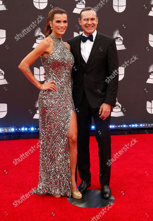 Stock Image of Cristina Bernal (L) and Alan Tacher (R) arrive for the 20th annual Latin Grammy Awards ceremony at the MGM Grand Garden Arena in Las Vegas, Nevada, USA, 14 November 2019. The Latin Grammys recognize artistic and/or technical achievement, not sales figures or chart positions, and the winners are determined by the votes of their peers - the qualified voting members of the Latin Recording Academy.