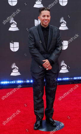 Stock Photo of De La Ghetto arrives for the 20th annual Latin Grammy Awards ceremony at the MGM Grand Garden Arena in Las Vegas, Nevada, USA, 14 November 2019. The Latin Grammys recognize artistic and/or technical achievement, not sales figures or chart positions, and the winners are determined by the votes of their peers - the qualified voting members of the Latin Recording Academy.
