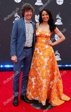 Roberto Musso (L) and guest arrive for the 20th annual Latin Grammy Awards ceremony at the MGM Grand Garden Arena in Las Vegas, Nevada, USA, 14 November 2019. The Latin Grammys recognize artistic and/or technical achievement, not sales figures or chart positions, and the winners are determined by the votes of their peers - the qualified voting members of the Latin Recording Academy.