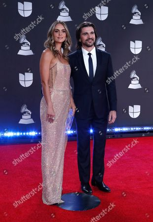 Stock Photo of Juanes (R) and his wife Karen Martinez arrive for the 20th annual Latin Grammy Awards ceremony at the MGM Grand Garden Arena in Las Vegas, Nevada, USA, 14 November 2019. The Latin Grammys recognize artistic and/or technical achievement, not sales figures or chart positions, and the winners are determined by the votes of their peers - the qualified voting members of the Latin Recording Academy.