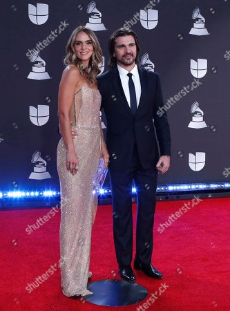 Juanes (R) and his wife Karen Martinez arrive for the 20th annual Latin Grammy Awards ceremony at the MGM Grand Garden Arena in Las Vegas, Nevada, USA, 14 November 2019. The Latin Grammys recognize artistic and/or technical achievement, not sales figures or chart positions, and the winners are determined by the votes of their peers - the qualified voting members of the Latin Recording Academy.