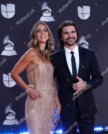 Stock Picture of Juanes (R) and his wife Karen Martinez arrive for the 20th annual Latin Grammy Awards ceremony at the MGM Grand Garden Arena in Las Vegas, Nevada, USA, 14 November 2019. The Latin Grammys recognize artistic and/or technical achievement, not sales figures or chart positions, and the winners are determined by the votes of their peers - the qualified voting members of the Latin Recording Academy.
