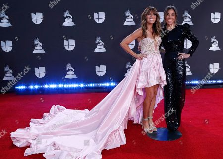 Kany Garcia (L) and Jocelyn Trochez arrive for the 20th annual Latin Grammy Awards ceremony at the MGM Grand Garden Arena in Las Vegas, Nevada, USA, 14 November 2019. The Latin Grammys recognize artistic and/or technical achievement, not sales figures or chart positions, and the winners are determined by the votes of their peers - the qualified voting members of the Latin Recording Academy.