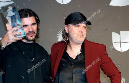 Juanes (L) holds the Person of the Year award as he poses with Lars Ulrich in the press room during the 20th annual Latin Grammy Awards ceremony at the MGM Grand Garden Arena in Las Vegas, Nevada, USA, 14 November 2019. The Latin Grammys recognize artistic and/or technical achievement, not sales figures or chart positions, and the winners are determined by the votes of their peers - the qualified voting members of the Latin Recording Academy.
