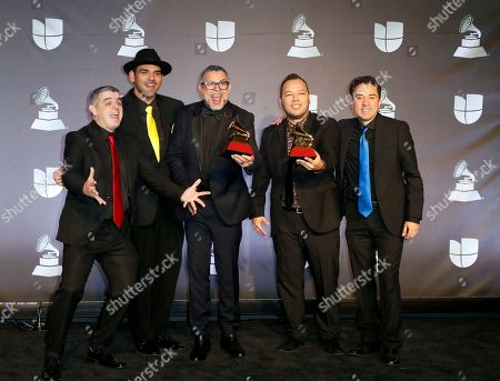 Rodner Padilla (2-R) with the 'Best Arrangement' award and Luis Enrique + C4 Trio with the 'Best Folk Album' award pose in the press room during the 20th annual Latin Grammy Awards ceremony at the MGM Grand Garden Arena in Las Vegas, Nevada, USA, 14 November 2019. The Latin Grammys recognize artistic and/or technical achievement, not sales figures or chart positions, and the winners are determined by the votes of their peers - the qualified voting members of the Latin Recording Academy.
