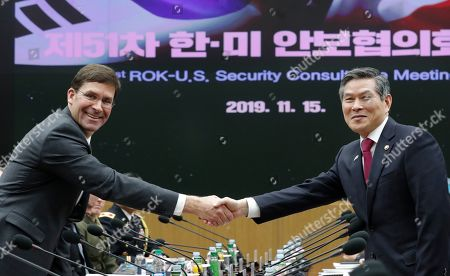 U.S. Defense Secretary Mark Esper, left, and South Korean Defense Minister Jeong Kyeong-doo shake hands for the media prior to the 51st Security Consultative Meeting (SCM) at Defense Ministry in Seoul, South Korea
