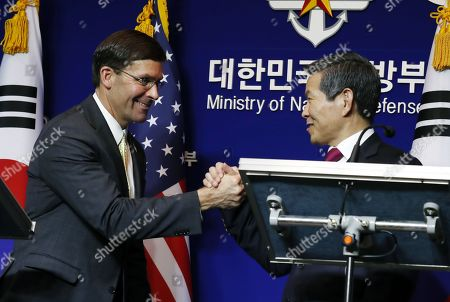US Secretary of Defense Mark Esper (L) and South Korean Minister of National Defense Jeong Kyeong-doo (R) shake hands during a press conference after their meeting at the Ministry of National Defense in Seoul, South Korea, 15 November 2019. US Secretary of Defense Mark Esper arrived in Seoul to hold the 51st Security Consultative Meeting (SCM).