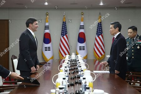 U.S. Defense Secretary Mark Esper, left, talks with South Korean Defense Minister Jeong Kyeong-doo, during their meeting in Seoul, South Korea