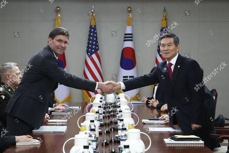 US Secretary of Defense Mark Esper (C, left) and South Korean Minister of National Defense Jeong Kyeong-doo (C, right) shake hands during a meeting at the Ministry of National Defense in Seoul, South Korea, 15 November 2019. US Secretary of Defense Mark Esper arrived in Seoul to hold the 51st Security Consultative Meeting (SCM).