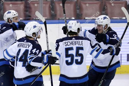 Patrik Laine, Josh Morrissey, Mark Scheifele. Winnipeg Jets right wing Patrik Laine, right, celebrates with defenseman Josh Morrissey (44) and center Mark Scheifele (55) after scoring a goal during the third period of an NHL hockey game against the Florida Panthers, in Sunrise, Fla