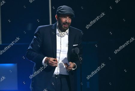 "Stock Image of Juan Luis Guerra accepts the award for best contemporary/tropical fusion album for ""Literal"" at the 20th Latin Grammy Awards, at the MGM Grand Garden Arena in Las Vegas"