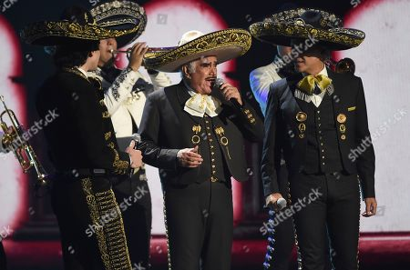 Stock Picture of Vicente Fernandez, Alejandro Fernandez, Alex Fernandez. Vicente Fernandez, center, his son Alejandro Fernandez, right, and his grandson Alex Fernandez perform a medley at the 20th Latin Grammy Awards, at the MGM Grand Garden Arena in Las Vegas
