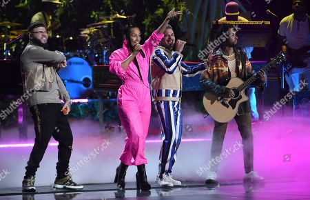Stock Photo of Farruko, Alicia Keys, Pedro Capo, Miguel. Farruko, from left, Alicia Keys, Pedro Capo and Miguel perform a medley at the 20th Latin Grammy Awards, at the MGM Grand Garden Arena in Las Vegas