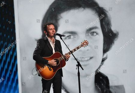 Stock Photo of Fonseca performs a tribute to Camilo Sesto, pictured on screen, at the 20th Latin Grammy Awards, at the MGM Grand Garden Arena in Las Vegas