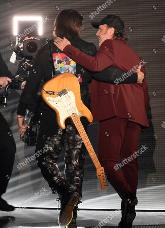 Lars Ulrich, Juanes. Lars Ulrich, of Metallica, right, and Juanes walk off stage after Juanes accepts the award for person of the year at the 20th Latin Grammy Awards, at the MGM Grand Garden Arena in Las Vegas