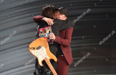 Lars Ulrich, Juanes. Lars Ulrich, of Metallica, right, hugs Juanes as he presents him with the award for person of the year at the 20th Latin Grammy Awards, at the MGM Grand Garden Arena in Las Vegas