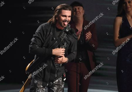 Juanes accepts the award for person of the year at the 20th Latin Grammy Awards, at the MGM Grand Garden Arena in Las Vegas
