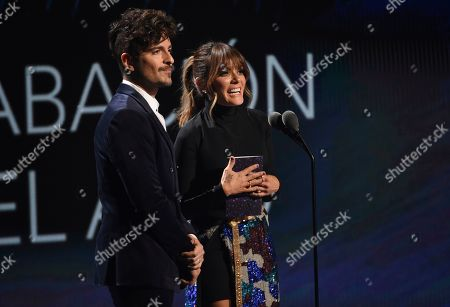 Tommy Torres, Kany Garcia. Tommy Torres, left, and Kany Garcia present the award for record of the year at the 20th Latin Grammy Awards, at the MGM Grand Garden Arena in Las Vegas