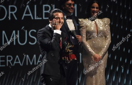 "Christian Nodal accepts the award for best ranchero/mariachi album for ""Ahora"" at the 20th Latin Grammy Awards, at the MGM Grand Garden Arena in Las Vegas"