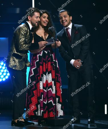 Alessia Cara, Cristian Nodal, Luis Gerado Mendez. Luis Gerado Mendez, from left, Alessia Cara and Cristian Nodal present the award for best tropical fusion album at the 20th Latin Grammy Awards, at the MGM Grand Garden Arena in Las Vegas