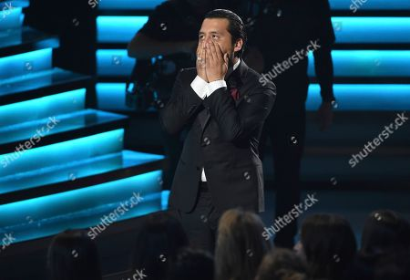 "Christian Nodal reacts as he walks to the stage to accept the award for best ranchero/mariachi album for ""Ahora"" at the 20th Latin Grammy Awards, at the MGM Grand Garden Arena in Las Vegas"