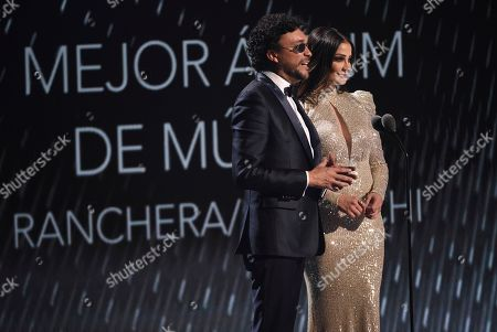 Andres Cepeda, Dayanara Torres. Andres Cepeda, left, and Dayanara Torres present the award for best ranchero mariachi album at the 20th Latin Grammy Awards, at the MGM Grand Garden Arena in Las Vegas