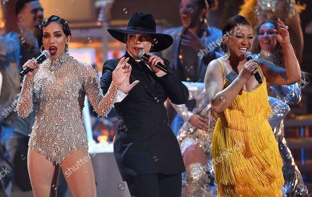 Olga Tanon, Milly Quezada, Anitta. Anitta, from left, Olga Tanon and Milly Quezada perform at the 20th Latin Grammy Awards, at the MGM Grand Garden Arena in Las Vegas