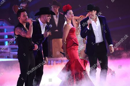Prince Royce, Natalia Jimenez, Calibre 50. Prince Royce, left, Natalia Jimenez, second from right, and members of Calibre 50 perform at the 20th Latin Grammy Awards, at the MGM Grand Garden Arena in Las Vegas