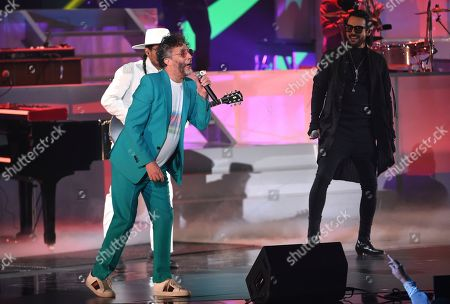 Stock Photo of Fito Paez, Beto Cuevas. Fito Paez, left, and Beto Cuevas perform at the 20th Latin Grammy Awards, at the MGM Grand Garden Arena in Las Vegas