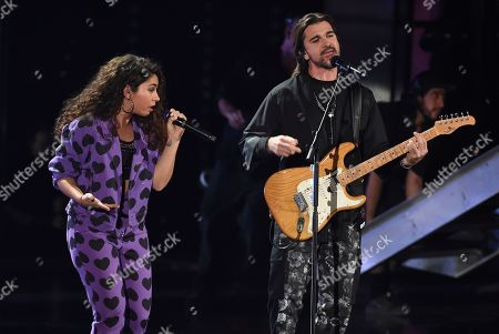 Juanes, Alessia Cara. Alessia Cara, left, and Juanes perform a medley at the 20th Latin Grammy Awards, at the MGM Grand Garden Arena in Las Vegas