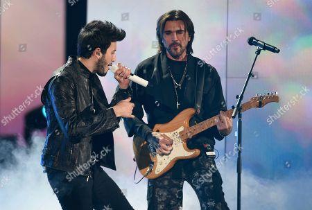 Juanes, Sebastian Yatra. Sebastian Yatra, left, and Juanes perform a medley at the 20th Latin Grammy Awards, at the MGM Grand Garden Arena in Las Vegas