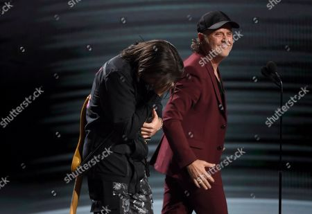 Lars Ulrich, Juanes. Lars Ulrich, of Metallica, right, presents Juanes with the award for person of the year at the 20th Latin Grammy Awards, at the MGM Grand Garden Arena in Las Vegas