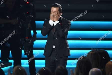 "Stock Image of Christian Nodal reacts as he accepts the award for best ranchero/mariachi album for ""Ahora"" at the 20th Latin Grammy Awards, at the MGM Grand Garden Arena in Las Vegas"