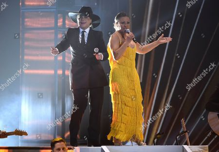 Olga Tanon, Milly Quezada. Olga Tanon, left, and Milly Quezada perform at the 20th Latin Grammy Awards, at the MGM Grand Garden Arena in Las Vegas
