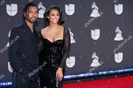 Miguel, Nazanin Mandi. Miguel, left, and Nazanin Mandi arrive at the 20th Latin Grammy Awards, at the MGM Grand Garden Arena in Las Vegas
