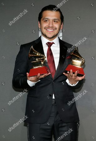 "Christian Nodal poses in the press room with the awards for best ranchero/mariachi album for ""Ahora,"" and best regional song for ""No Te Contaron Mal,"" at the 20th Latin Grammy Awards, at the MGM Grand Garden Arena in Las Vegas"