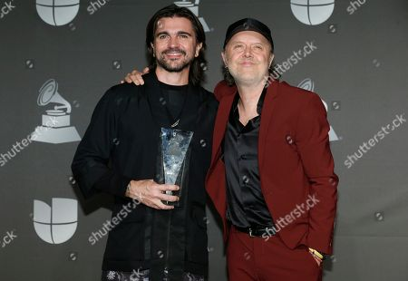 Juanes, Lars Ulrich. Juanes, winner of the person of the year award, left, poses with Lars Ulrich in the press room at the 20th Latin Grammy Awards, at the MGM Grand Garden Arena in Las Vegas